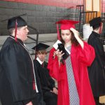 Student adjusting cap before graduation