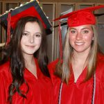 Two students await graduation