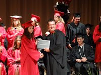 Board president hands out a diploma