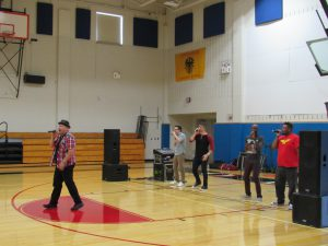 Men singing at assembly