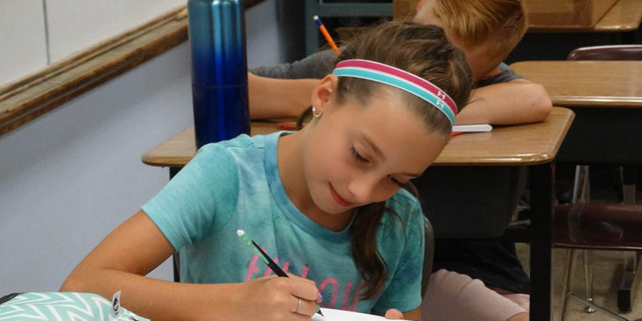 Student writing in class