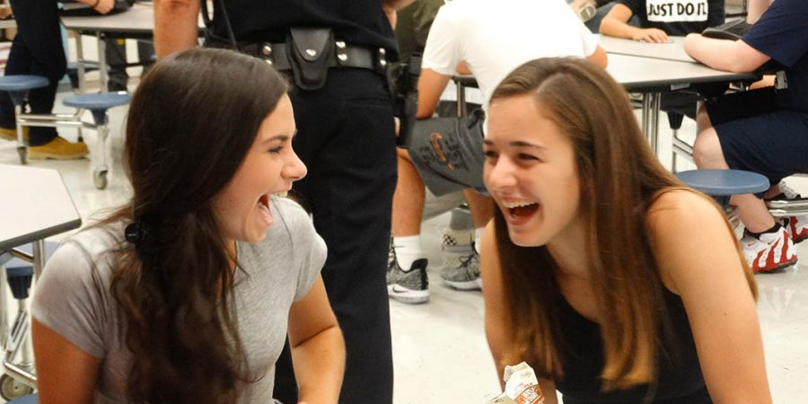 Students laughing at the cafeteria table