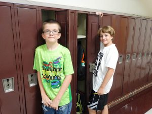 Students standing at their lockers