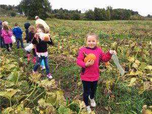 little girl with pumpkin