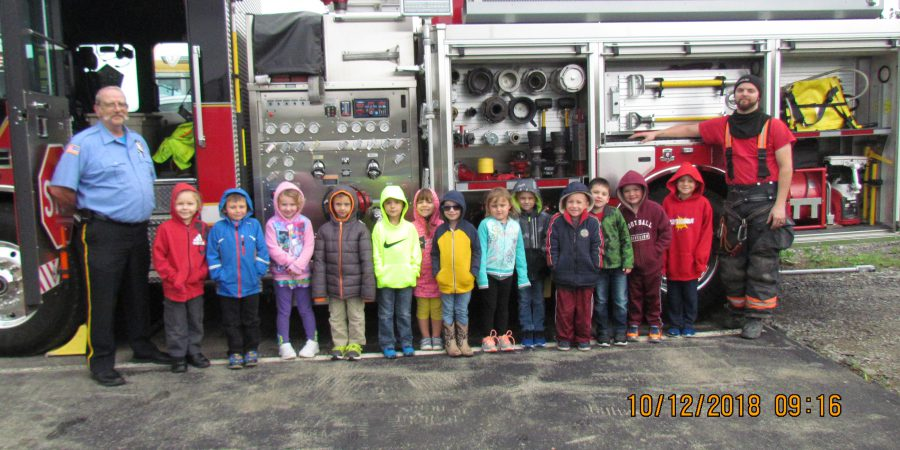 kids standing by fire truck