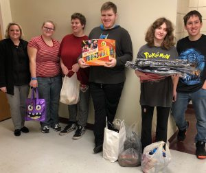 OESJ students hold donations from two community organizations