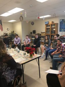 students meet with community members