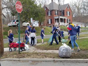 volunteers raking veterans lawn