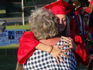 Student hugging a parent