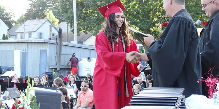 Student receiving a diploma