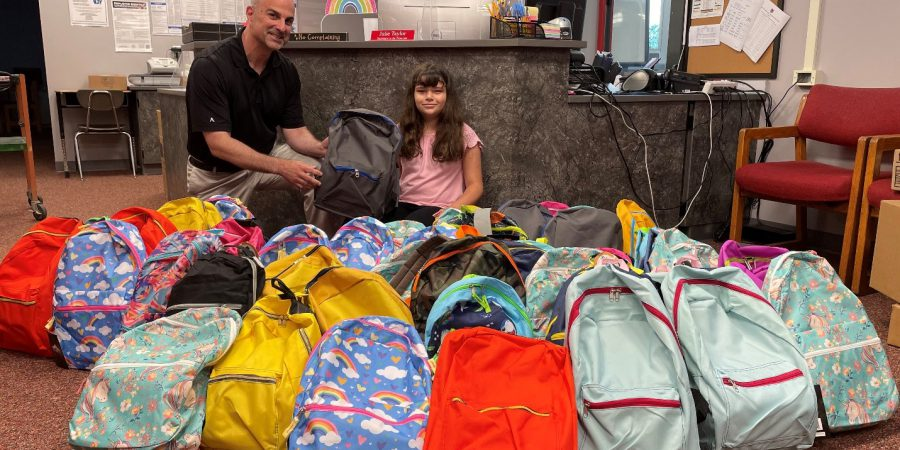 pic of backpacks filled with supplies